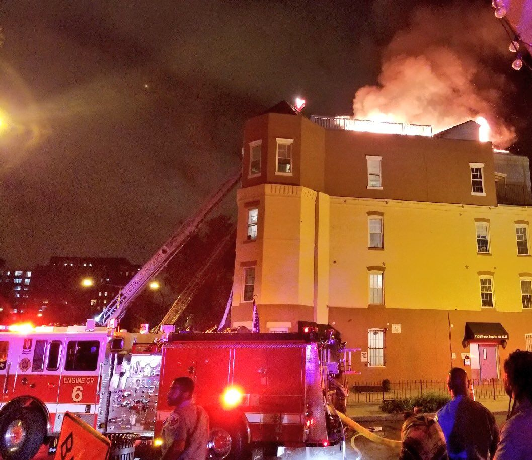 Firefighter responded to the fire on the roof deck of two four-story dwellings around 12 a.m. Monday. (Courtesy DC Fire and EMS)