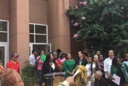 Education officials from D.C. crowded the school's courtyard to mark the academy's opening under DCPS. (Courtesy DCPS)