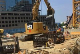 Workers dig a shaft down to the Bethesda Metro Station that will allow riders to transfer between the Metro system and Purple Line trains. (Courtesy Purple Line Transit Partners)