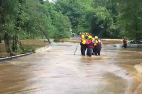 First responders rescue 2 trapped in car on flooded road in Fairfax Co.