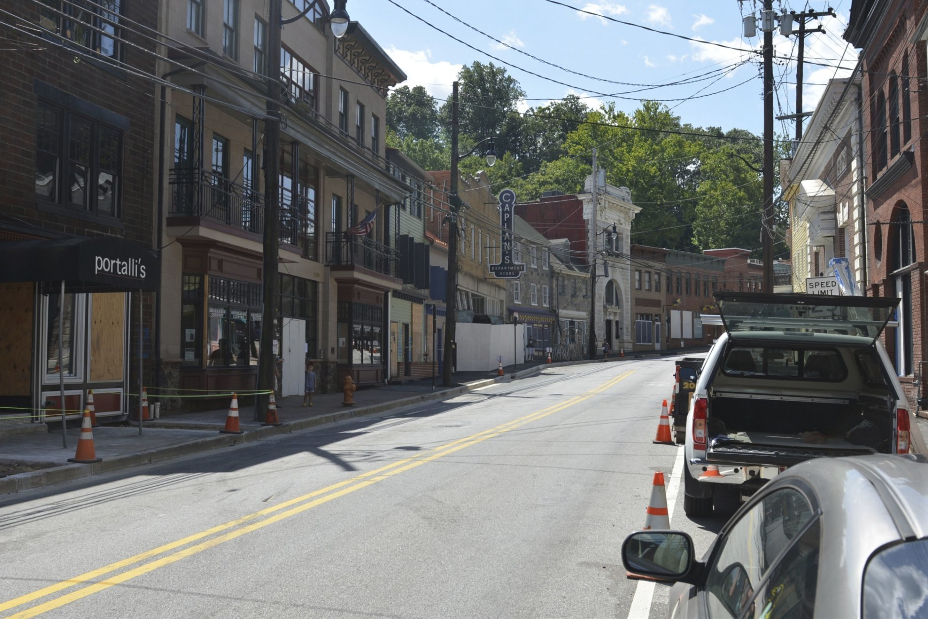 The main street of the former mill town is damaged from May floodwaters that killed a visitor and caused shops to be gutted Thursday, Aug. 23, 2018, in Ellicott City, Md. A few months after floodwaters devastated the town's main street for the second time in two years, authorities are moving to demolish roughly 5 percent of Ellicott City's historic district. (AP Photo/David McFadden)