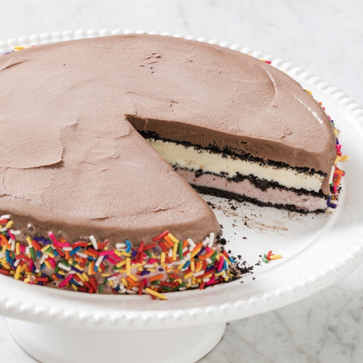 "This undated photo provided by America's Test Kitchen in July 2018 shows a basic ice cream cake in Brookline, Mass. This recipe appears in the cookbook ""The Perfect Cake."" (Daniel J. van Ackere/America's Test Kitchen via AP)"