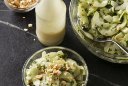 """This undated photo provided by America's Test Kitchen in July 2018 shows cucumber salad with creamy roasted garlic dressing in Brookline, Mass. This recipe appears in the cookbook """"Just Add Sauce."""" (Steve Klise/America's Test Kitchen via AP)"""