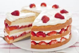 "This undated photo provided by America's Test Kitchen in July 2018 shows a strawberry cream cake in Brookline, Mass. This recipe appears in the cookbook ""Perfect Cake."" (Carl Tremblay/America's Test Kitchen via AP)"