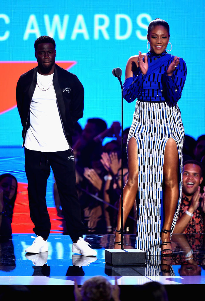 NEW YORK, NY - AUGUST 20:  Kevin Hart and Tiffany Haddish speak onstage during the 2018 MTV Video Music Awards at Radio City Music Hall on August 20, 2018 in New York City.  (Photo by Theo Wargo/Getty Images)