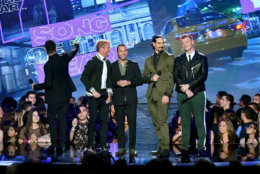NEW YORK, NY - AUGUST 20:  AJ McLean, Brian Littrell, Howie Dorough, Howie Dorough, and Nick Carter of Backstreet Boys speak onstage during the 2018 MTV Video Music Awards at Radio City Music Hall on August 20, 2018 in New York City.  (Photo by Michael Loccisano/Getty Images for MTV)