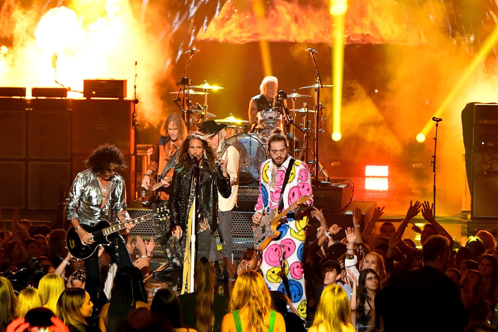 NEW YORK, NY - AUGUST 20:  (L-R) Joe Perry and Steven Tyler of Aerosmith perform with Post Malone onstage during the 2018 MTV Video Music Awards at Radio City Music Hall on August 20, 2018 in New York City.  (Photo by Michael Loccisano/Getty Images for MTV)