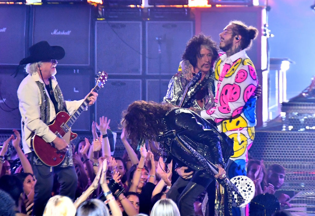 NEW YORK, NY - AUGUST 20:  (L-R) Brad Whitford, Joe Perry, and Steven Tyler of Aerosmith perform with Post Malone onstage during the 2018 MTV Video Music Awards at Radio City Music Hall on August 20, 2018 in New York City.  (Photo by Michael Loccisano/Getty Images for MTV)