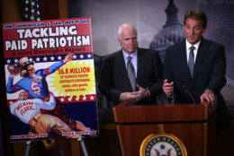 """WASHINGTON, DC - NOVEMBER 04:  U.S. Sen. John McCain (R-AZ) (L) and Sen. Jeff Flake (R-AZ) (R) speak to members of the media during a news conference November 4, 2015 on Capitol Hill in Washington, DC. The senators held the news conference to release and discuss a new government oversight report """"detailing widespread evidence of the Department of Defense paying professional sports teams and leagues such as the NFL, MLB and NHL to honor American soldiers at sporting events.""""  (Photo by Alex Wong/Getty Images)"""