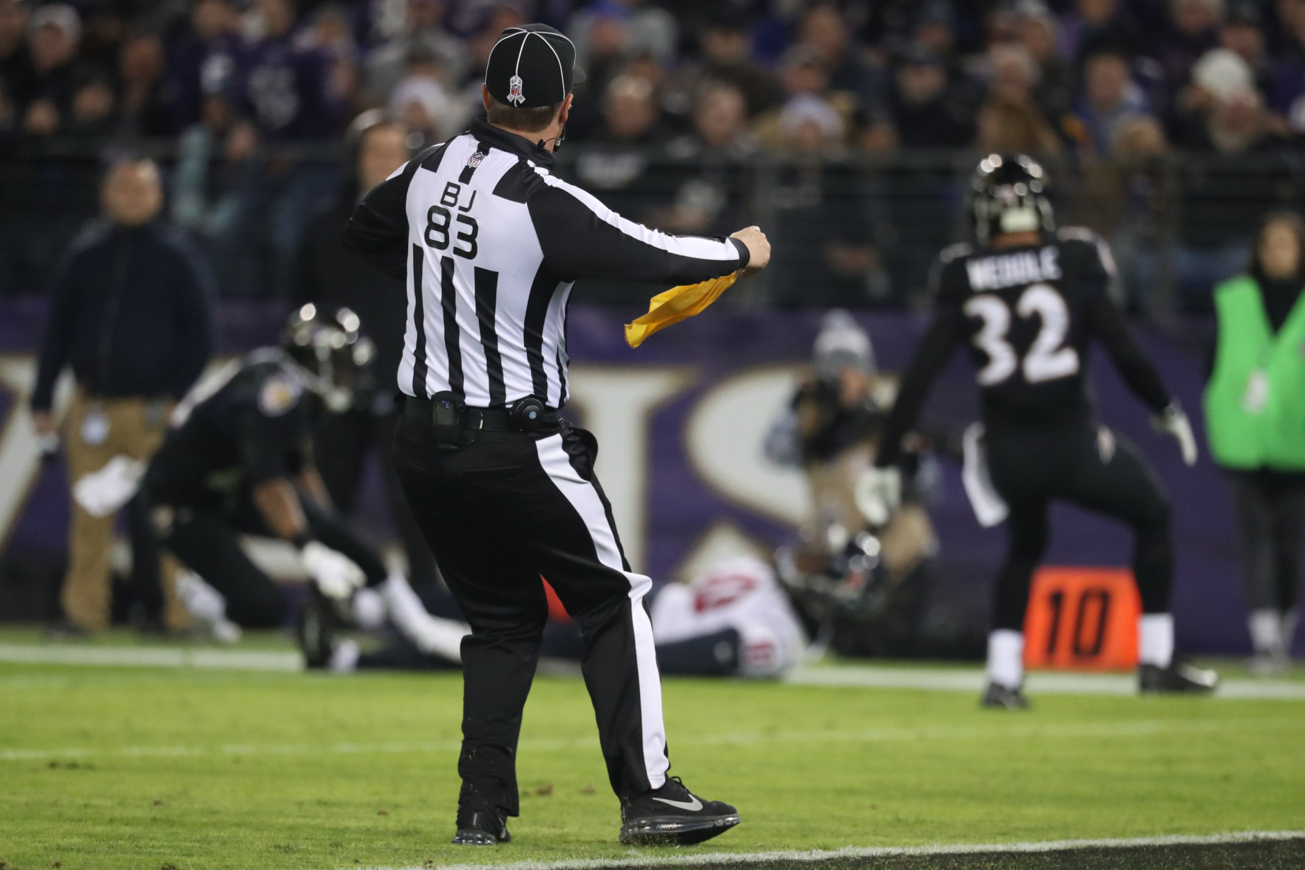 BALTIMORE, MD - NOVEMBER 27: Back Judge Shawn  Hochuli throws a flag in the third quarter between the Baltimore Ravens and the Houston Texans at M&T Bank Stadium on November 27, 2017 in Baltimore, Maryland. (Photo by Rob Carr/Getty Images)
