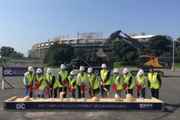 City officials take part in a groundbreaking ceremony in RFK's Lot 7. (WTOP/Noah Frank)