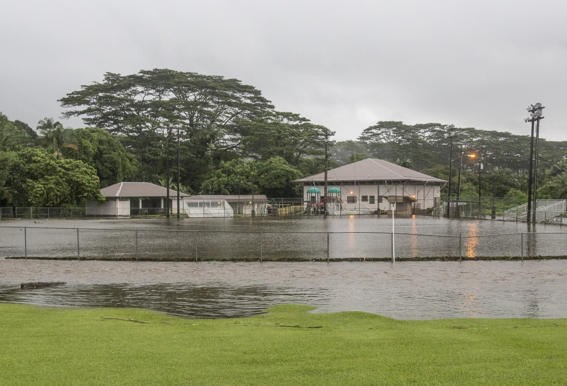 Park fields are flooded from heavy rains Thursday, Aug. 23, 2018, in Hilo, Hawaii. Hurricane Lane soaked Hawaii's Big Island on Thursday, dumping nearly 20 inches of rain in nearly 24 hours as residents stocked up on supplies and tried to protect their homes ahead of the state's first hurricane since 1992. (Hollyn Johnson/Hawaii Tribune-Herald via AP)