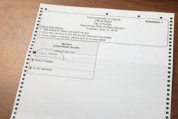 Ballots that elections officers saw Friday included one in which a voter appeared to pick Prince William County Board Chairman Corey Stewart after filling in too many circles. (WTOP/Max Smith)