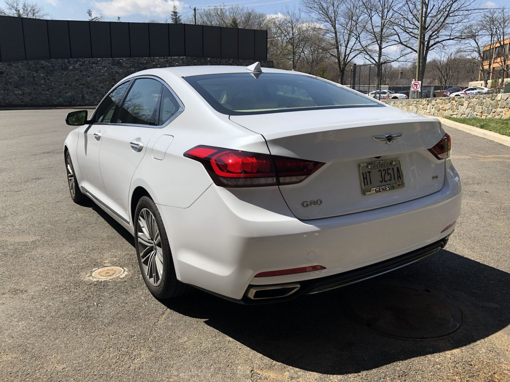 The Genesis G80 is a handsome ride, if not very exciting. Out back dual exhaust tips and some chrome trim pieces dress up the car. (WTOP/Mike Parris)