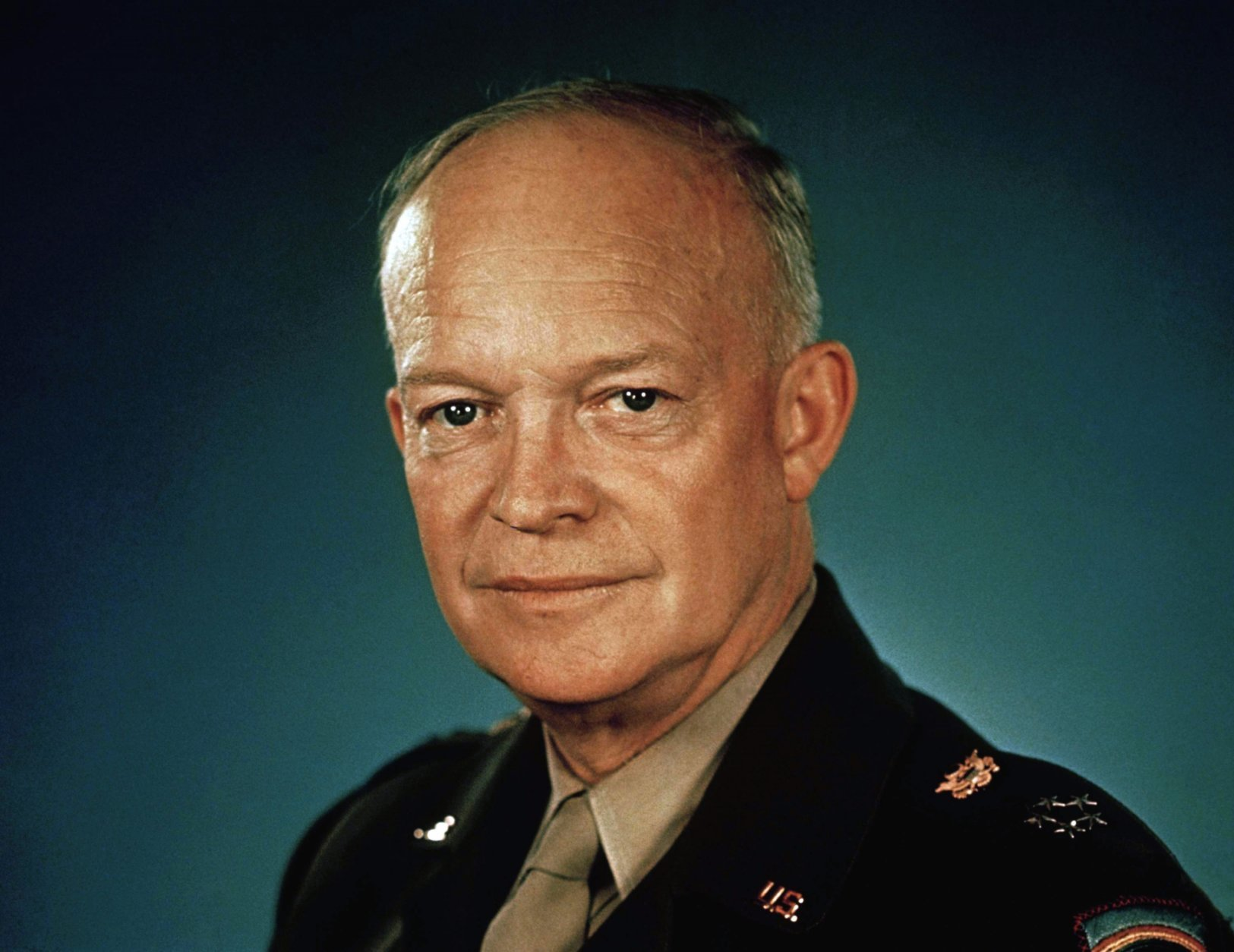 """File-This 1945 file photo shows General Dwight D. Eisenhower in uniform. The plain green telephone Eisenhower used at his summer residence in Rhode Island has sold at auction. The Newport Daily News reports that the phone with no numbers or dial was sold earlier this month by Bruneau & Co. Auctioneers of Cranston for $1,375. The telephone was Eisenhower's personal telephone at the """"Summer White House"""" in Newport. (AP Photo/File)"""