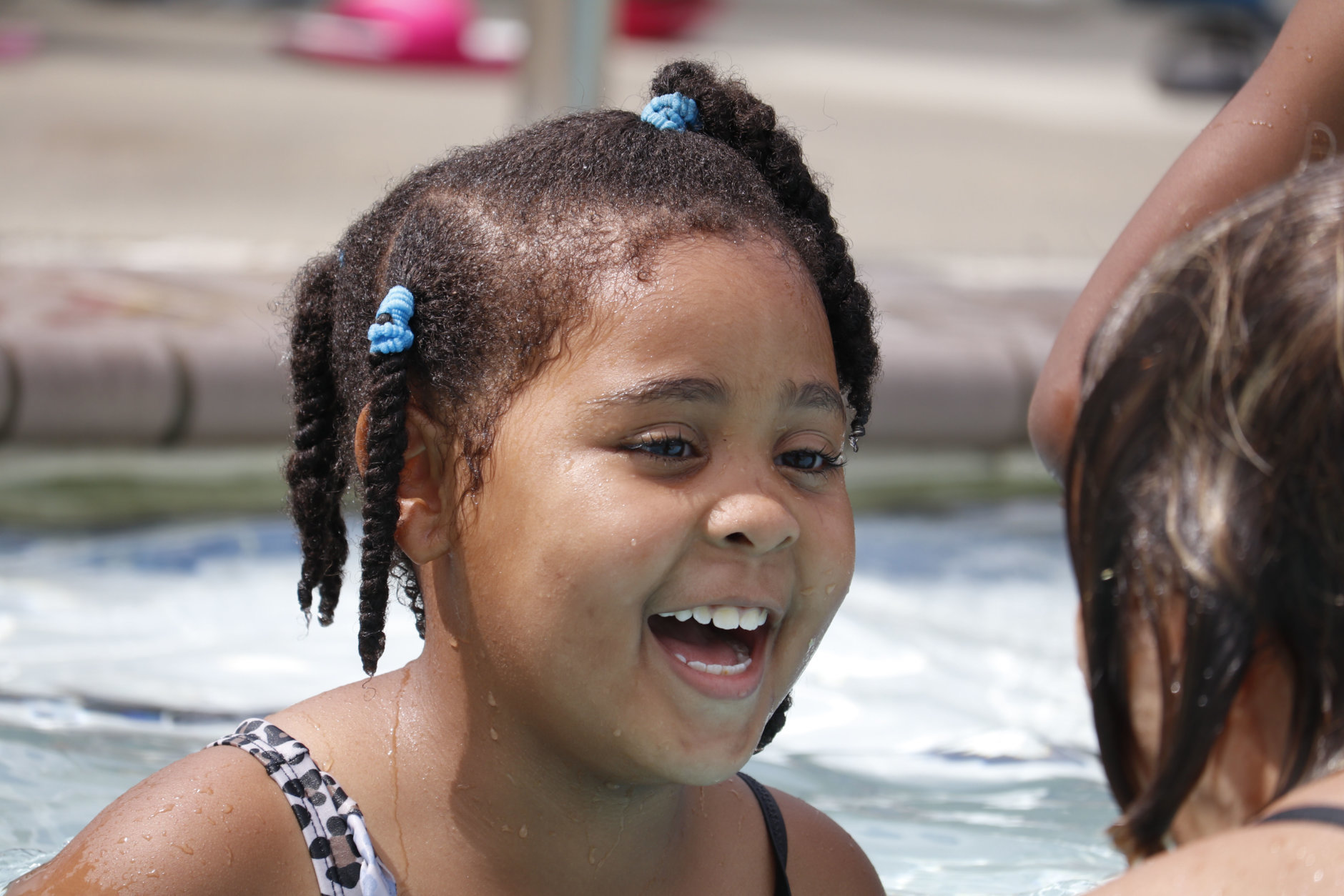 "A little girl nearby giggled as she practiced her breathing, and Broome jokingly fell backward into the water, creating a big splash, and telling her, ""You have to stop blowing so hard! You're tipping me over!"" (WTOP/Kate Ryan)"