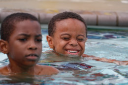 A group of boys surprised themselves, bobbing their faces into the water, popping up for air and bursting into smiles and laughter as they mastered their new skill. (WTOP/Kate Ryan)