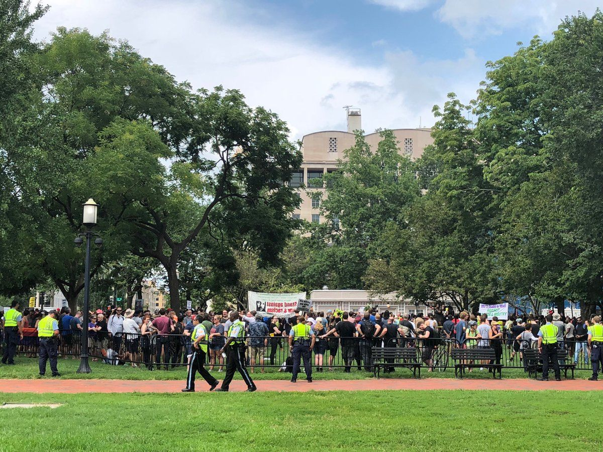 Counterprotesters waiting in Lafayette Square for Unite the Right 2 protesters marching from the Foggy Bottom Metro station. (WTOP/Keara Dowd)