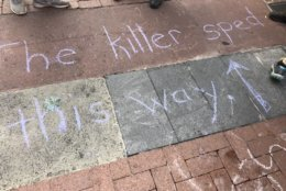 """Photo of a chalk memorial that says 'The Killer Sped this way"""""""