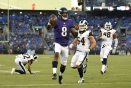 Baltimore Ravens quarterback Lamar Jackson (8) scores a touchdown in the first half of a preseason NFL football game against the Los Angeles Rams, Thursday, Aug. 9, 2018, in Baltimore. (AP Photo/Nick Wass)