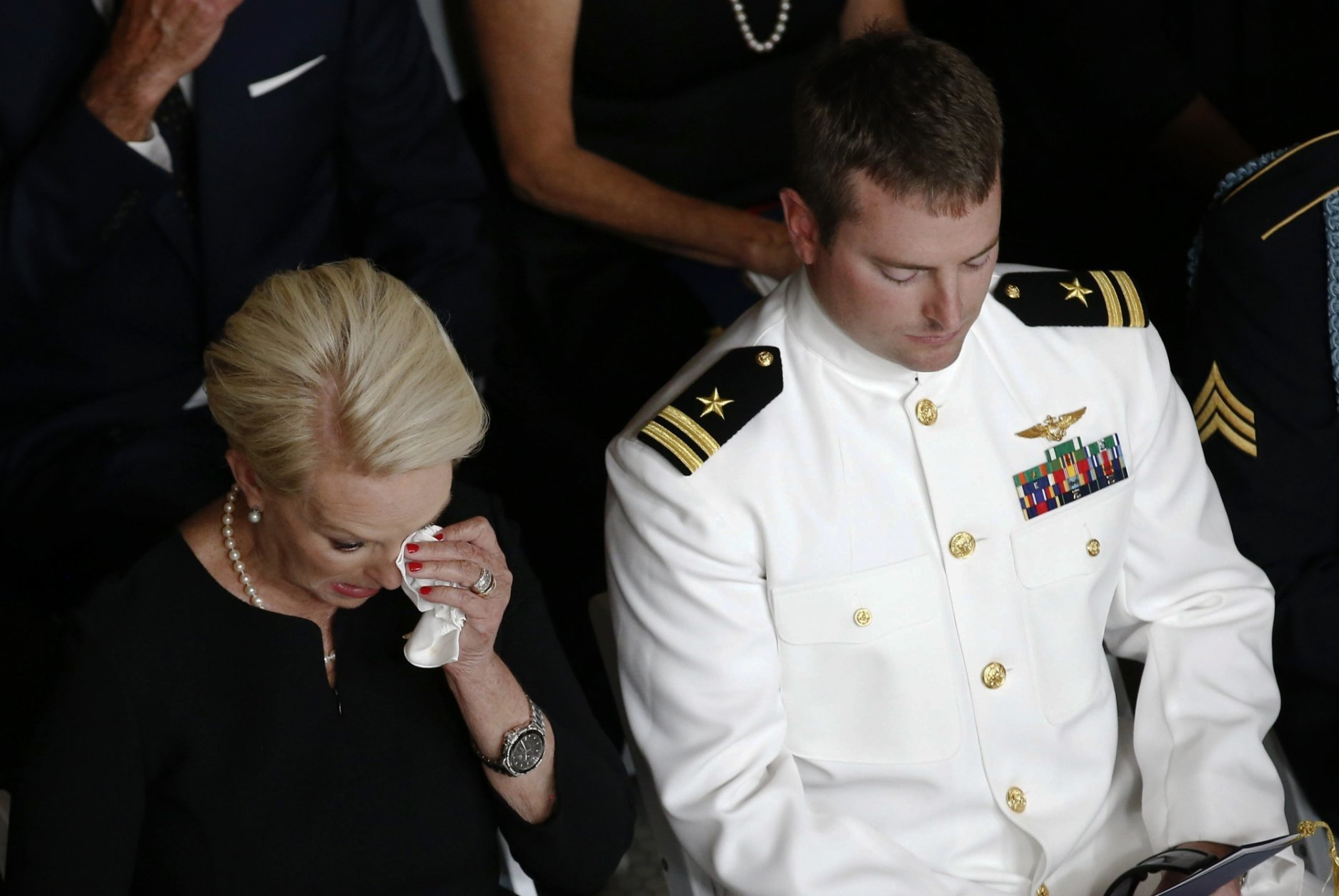 Cindy McCain, wife of Sen. John McCain, R-Ariz., wipes a tear away next to her son Jack during a memorial service at the Arizona Capitol on Wednesday, Aug. 29, 2018, in Phoenix. (AP Photo/Ross D. Franklin, Pool)