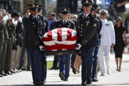 Military personal carry the casket of Sen. John McCain, R-Ariz., into the Capitol rotunda for a memorial service, Wednesday, Aug. 29, 2018, at the Capitol in Phoenix. (AP Photo/Matt York)