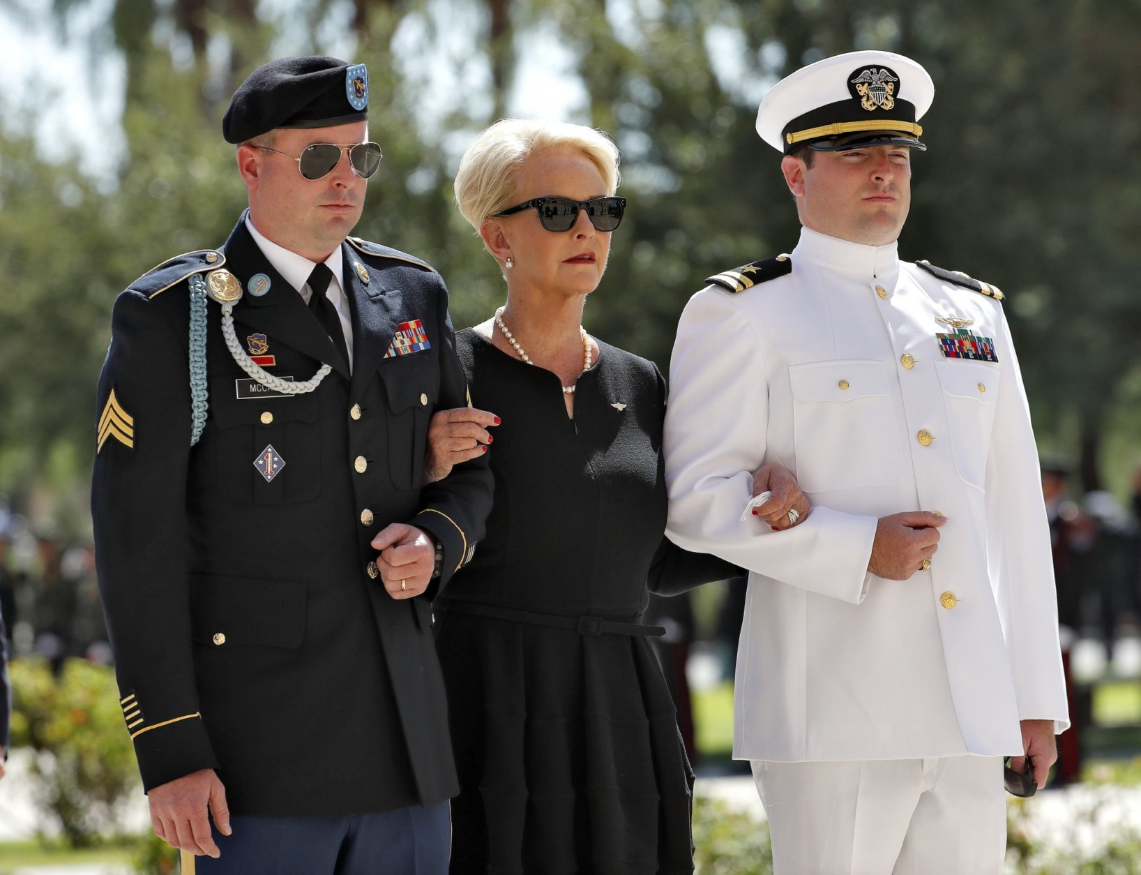 Cindy McCain, escorted by sons, Jack McCain, right, and Jimmy McCain, follow behind military personal carrying the casket of Sen. John McCain, R-Ariz., into the Capitol rotunda for a memorial service, Wednesday, Aug. 29, 2018, at the Capitol in Phoenix. (AP Photo/Matt York)