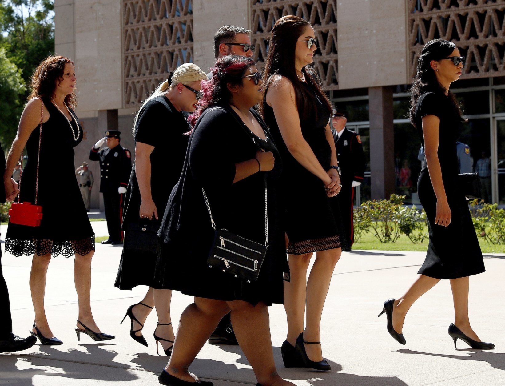Children of Sen. John McCain, R-Ariz., from back left, Sidney McCain, Meghan McCain and her husband Ben Domenech, Bridgett McCain, and daughter-in-laws Holly McCain and Renee Swift, follow behind the casket into the Capitol rotunda for a memorial service, Wednesday, Aug. 29, 2018, at the Capitol in Phoenix.(AP Photo/Matt York)
