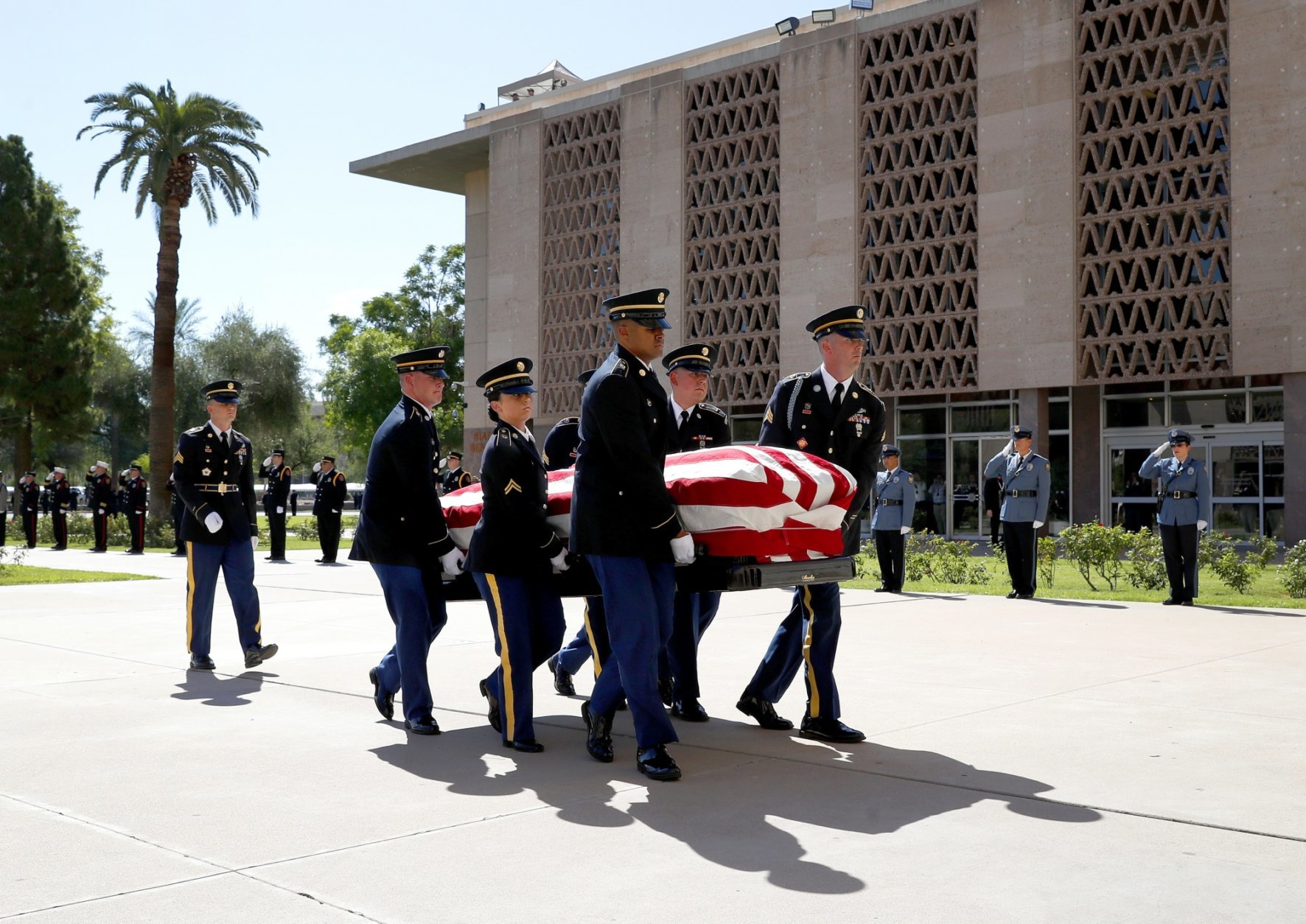 Members of the Arizona National Guard  carry the casket of Sen. John McCain, R-Ariz., into the Capitol rotunda for a memorial service, Wednesday, Aug. 29, 2018, at the Capitol in Phoenix. (AP Photo/Matt York)