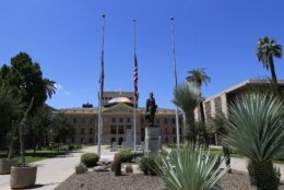 FILE - In this Aug. 26, 2018, file photo, flags fly at half-staff at the Arizona Capitol in memory of the late Sen. John McCain, in Phoenix. McCain's body lies in state Wednesday, Aug. 29, 2018, at the Capitol in Arizona, his home state. (AP Photo/Ross D. Franklin, file)