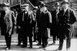 Italian immigrants Nicola Sacco, second from right foreground, and Bartolomeo Vanzetti, second from left foreground, stand in handcuffs with unidentified escorts in Massachusetts around 1927. Sacco and Vanzetti, arrested in 1920, were accused of killing a  paymaster and guard in Braintree, and stealing about $16,000.  Many believed they were convicted because of their anarchistic beliefs. Their scheduled execution was protested by ordinary and prominent men and women. The city of Boston will use a bronze sculpture of Sacco and Vanzetti to say the two men, executed 70 years ago, did not get a fair trial, said Mayor Thomas M. Menino, Tuesday, Aug. 19, 1997. On the anniversary of the executions, Saturday, Aug. 23, 1997, Menino will commission the sculpture which is to be in place by the year 2000, but it has not been decided where. (AP Photo/File)