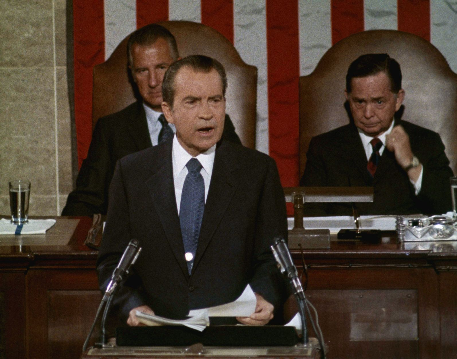 President Richard Nixon addresses a Joint Session of Congress, Sept. 9, 1971, to explain his new economic policy following his sudden freeze on prices, rents and wages of Aug. 15. Seated behind him on the dais are Vice President Spiro Agnew, acting as president of the Senate, and Speaker of the House Carl Albert. (AP Photo)