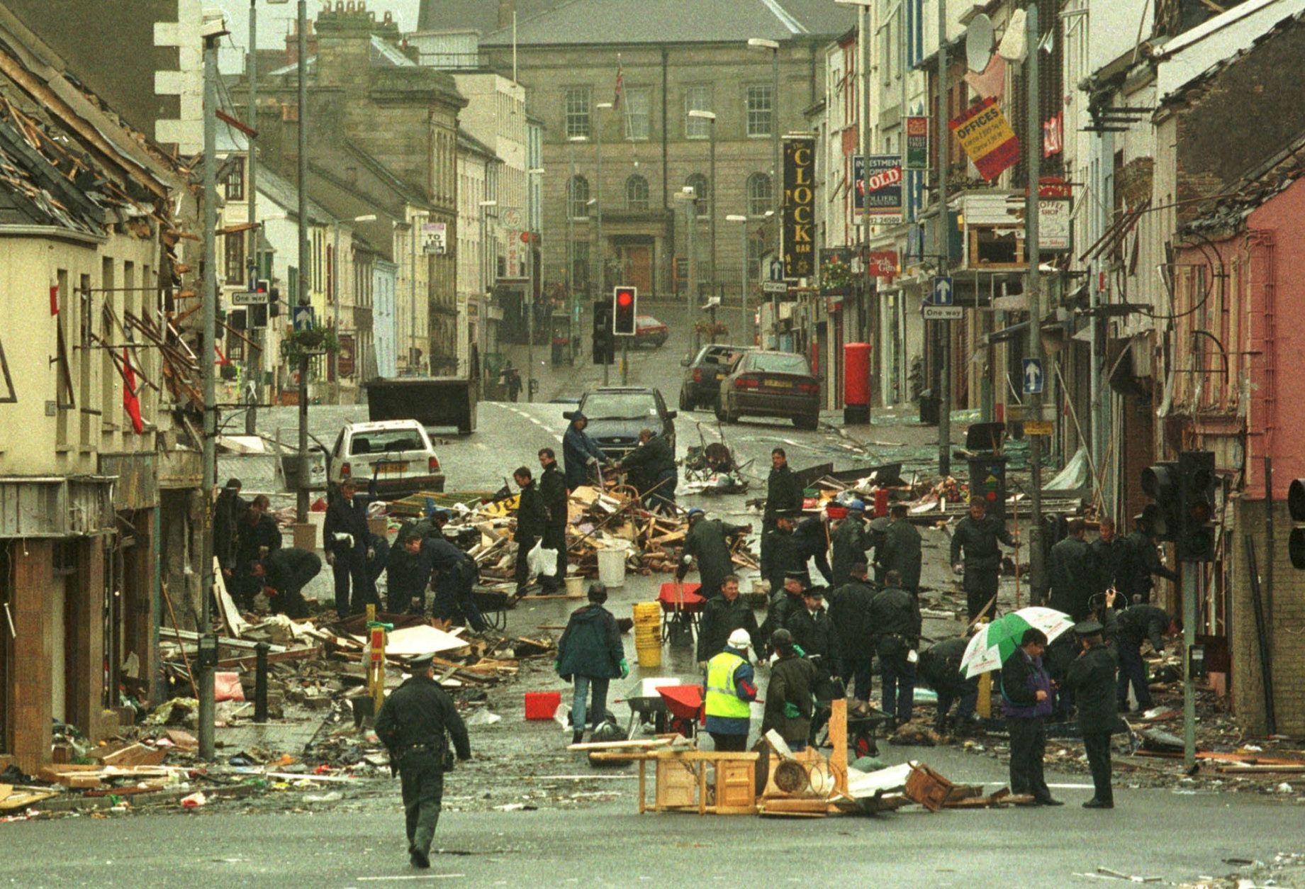 RUC officers look at the debris Sunday, August 16, 1998, following yesterday's bomb in Omagh town centre. The bomb exploded Saturday afternoon killing 28 people and injuring a further 220. (AP Photo/Alastair Grant).