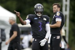 Baltimore Ravens quarterback Robert Griffin III (3) laughs during a joint practice with the at the Indianapolis Colts NFL football training camp in Westfield, Ind., Friday, Aug. 17, 2018. (AP Photo/Michael Conroy)