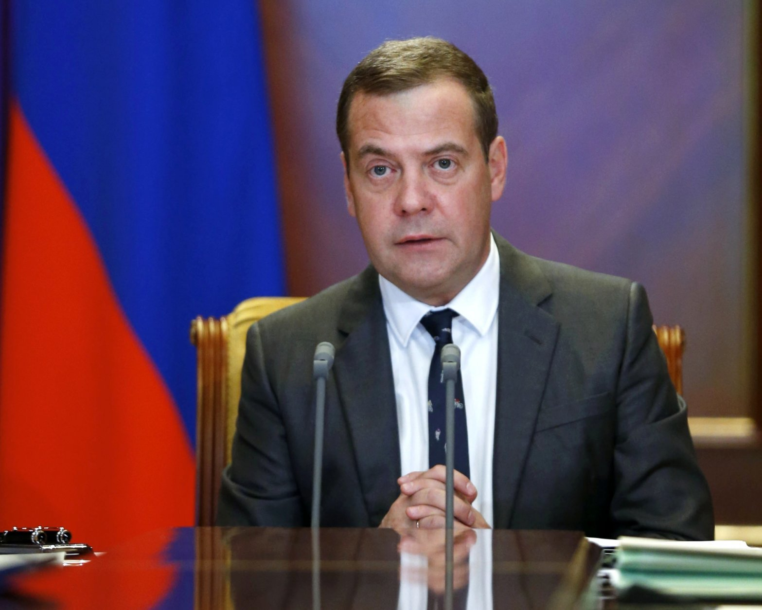 "Russian Prime Minister Dmitry Medvedev leads a cabinet meeting in the Gorky residence outside Moscow, Georgia, Wednesday, Aug. 29, 2018. Russian President Vladimir Putin said in a televised address Wednesday said without raising the retirement age Russia's pension system ""would crack and eventually collapse."" He offered concessions to the reform, saying that women's retirement age should increase from 55 to 60 years, lower than had proposed. (Dmitry Astakhov, Sputnik, Government Pool Photo via AP)"