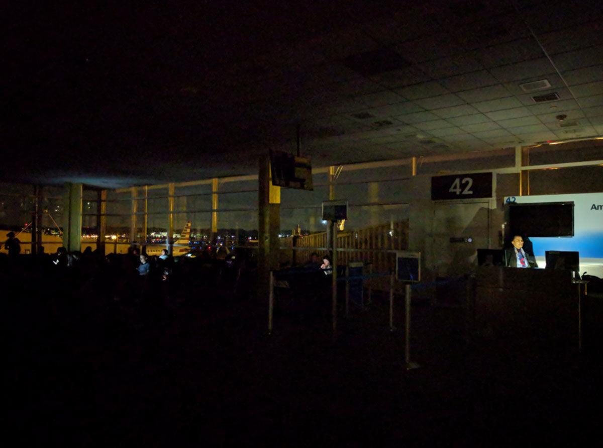 "Travelers at Reagan National Airport sit in the dark on Wednesday, Aug. 15, 2018. (Courtesy Samuel Breslow via Twitter <a href=""https://twitter.com/sdkb42/status/1029906897447669760"">@sdkb42</a>)"
