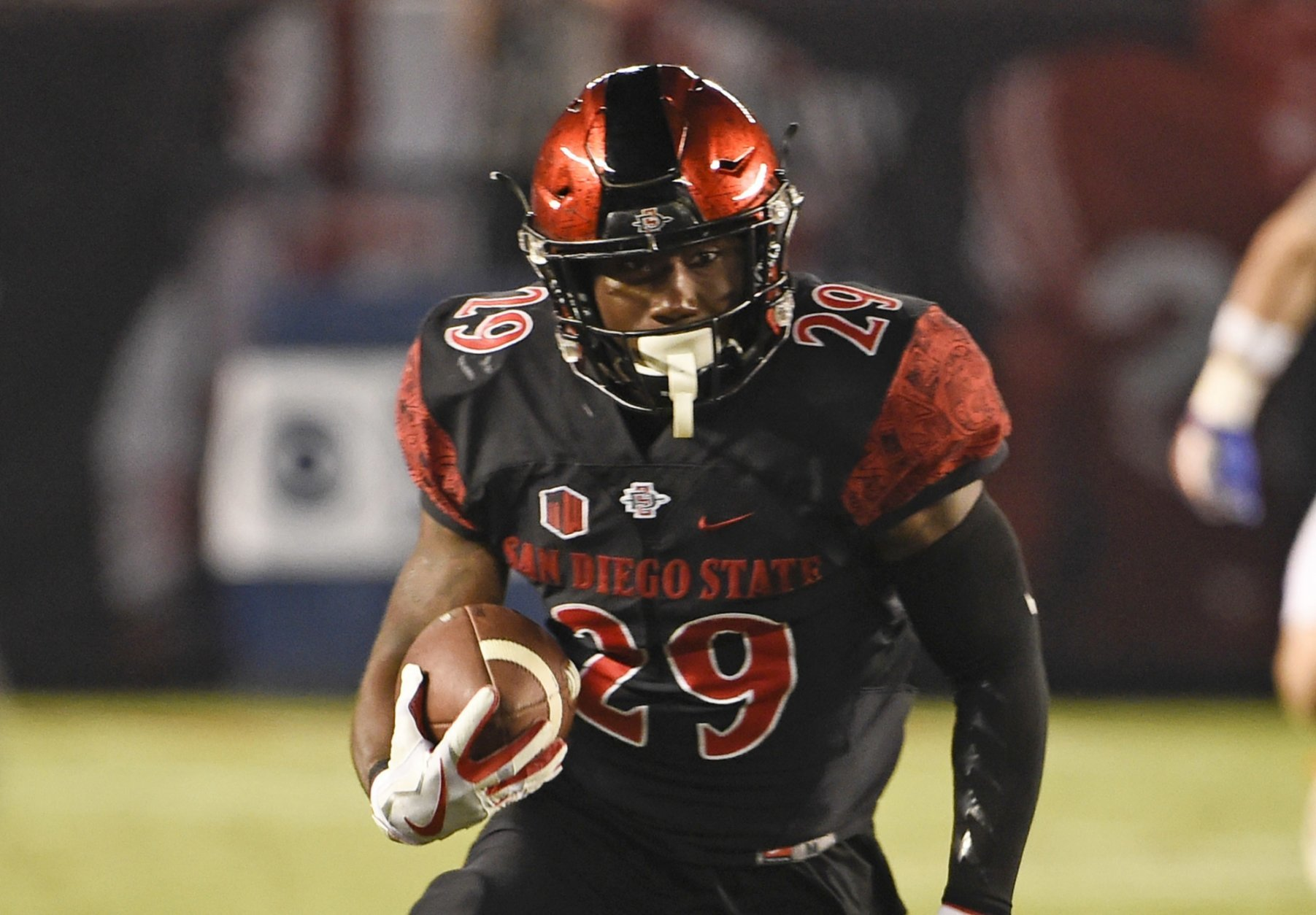 FILE - In this Oct. 14, 2017, file photo, San Diego State running back Juwan Washington runs during an NCAA college football game against Boise State in San Diego. Washington is ready for his turn to be San Diego State's featured running back. If he's as successful as D.J. Pumphrey and Rashaad Penny before him, the Aztecs will have their third straight 2,000-yard rusher. (AP Photo/Denis Poroy, file)