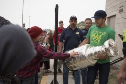 Washington Capitals left wing Chandler Stephenson carries the Stanley Cup outside Elgar Petersen Arena during the Humboldt Hockey Day event in Humboldt, Saskatchewan, Friday, Aug. 24, 2018. (Kayle Neis/The Canadian Press via AP)
