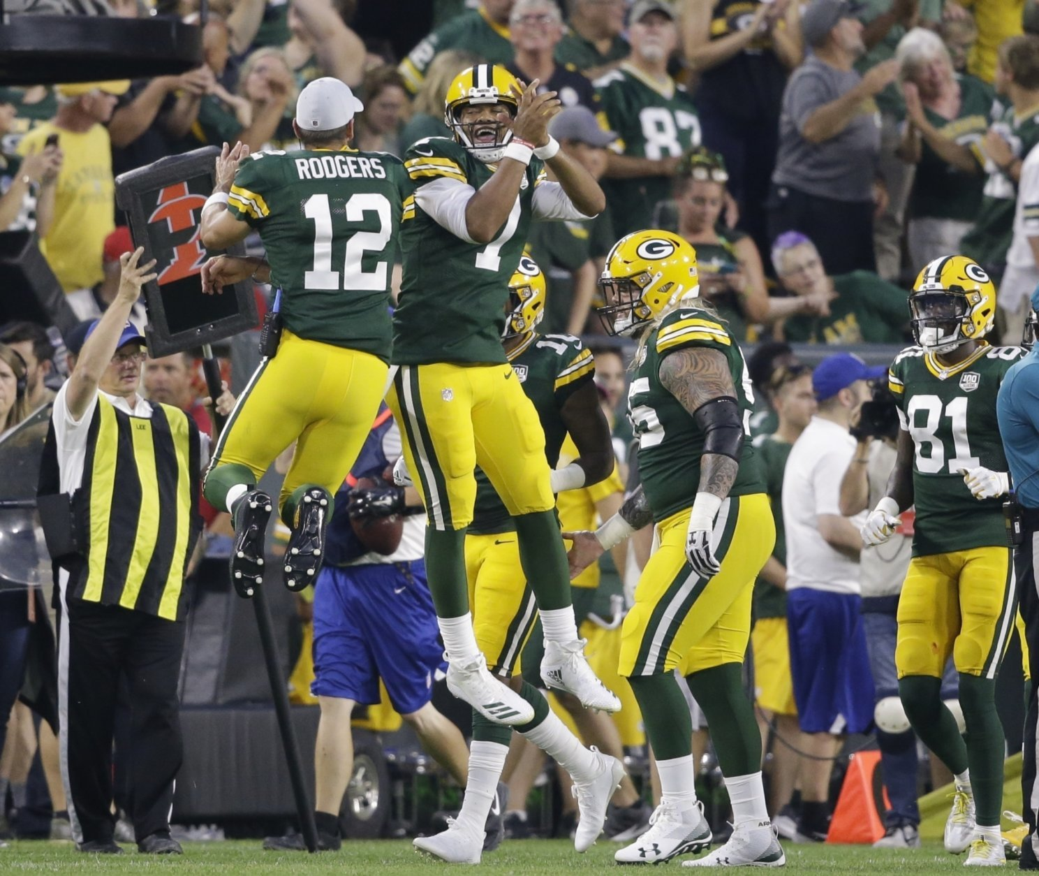 Green Bay Packers' Brett Hundley celebrates his touchdown run with Aaron Rodgers (12) during the first half of a preseason NFL football game against the Pittsburgh Steelers Thursday, Aug. 16, 2018, in Green Bay, Wis. (AP Photo/Jeffrey Phelps)