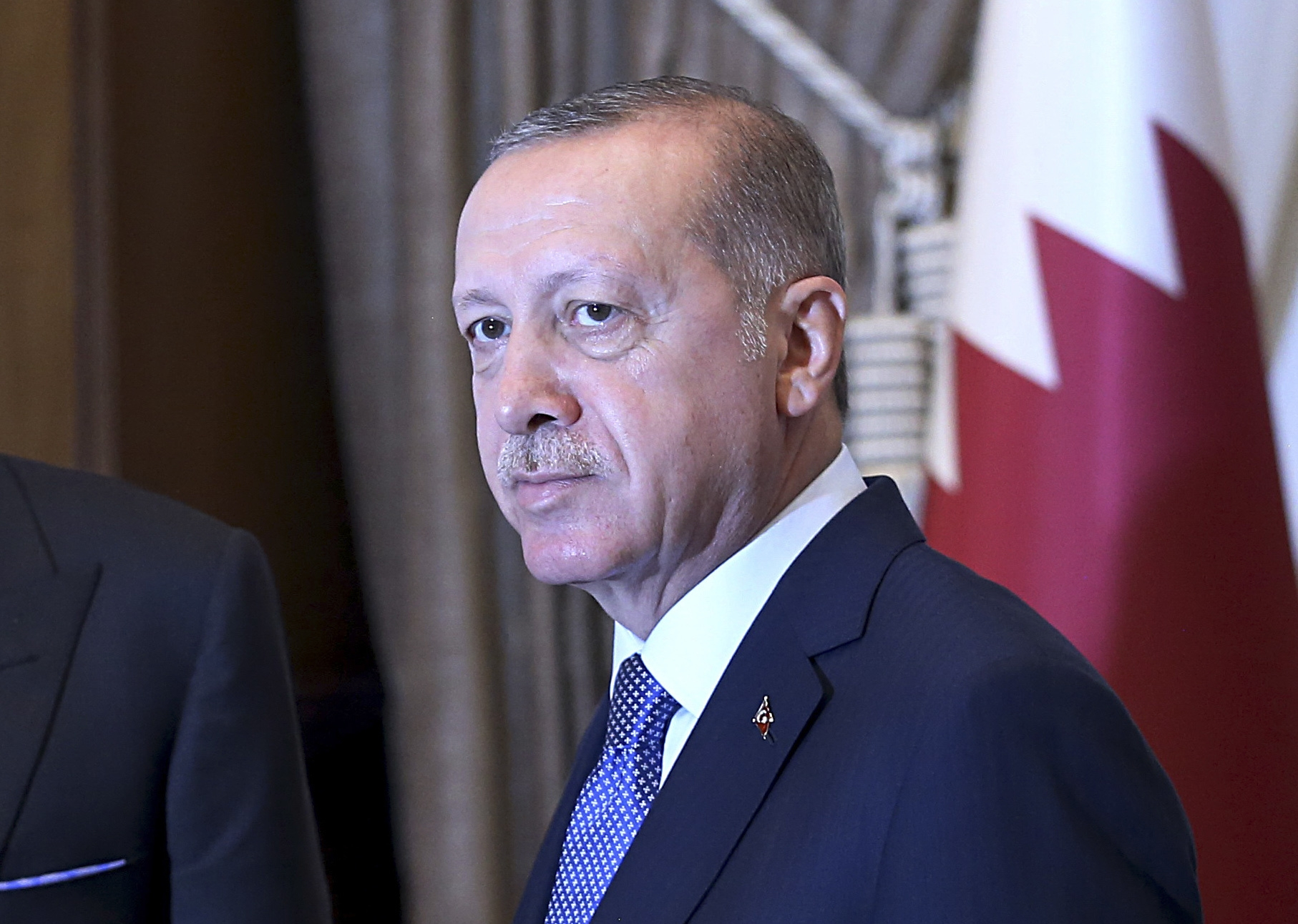The Latest: Turkish, French presidents speak by phone