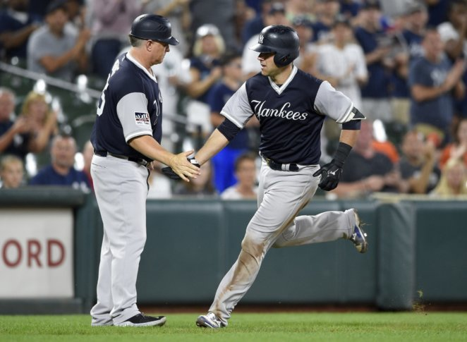 b9163cc8 ... York Yankees' Austin Romine, right, is greeted by third base coach Phil  Nevin as he runs he bases with a home run during the ninth inning of the  second ...