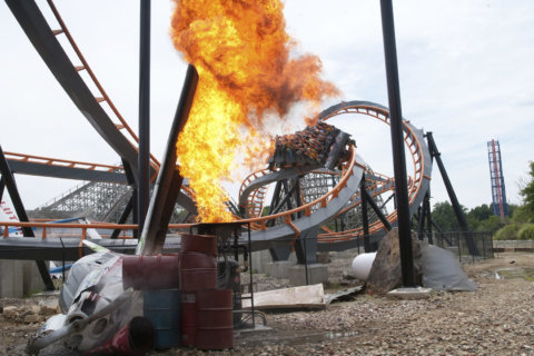 Six Flags America is closing its Apocalypse stand-up roller coaster