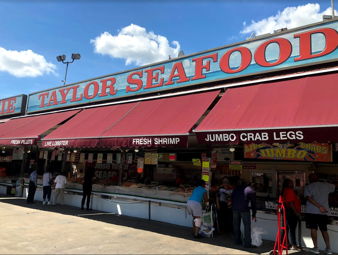 At the fish market in Southwest D.C., people line up for the regional staple at Jessie Taylor Seafood. (WTOP/Mike Murillo)