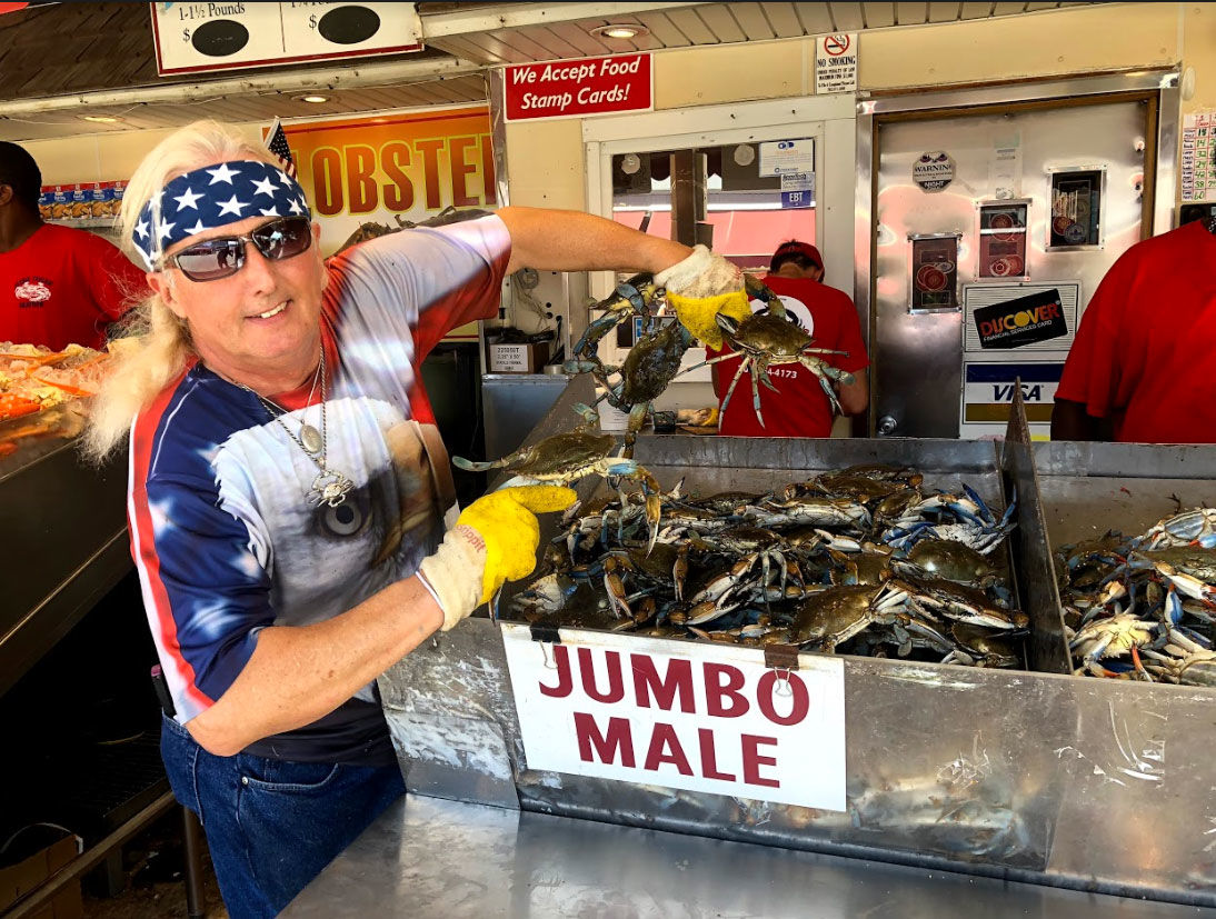 """""""Right now, we're happy; the Chesapeake Bay is having a good year finally,"""" said Clarence Goodman, who has sold crabs along the Southwest Waterfront in D.C. for 47 years. (WTOP/Mike Murillo)"""