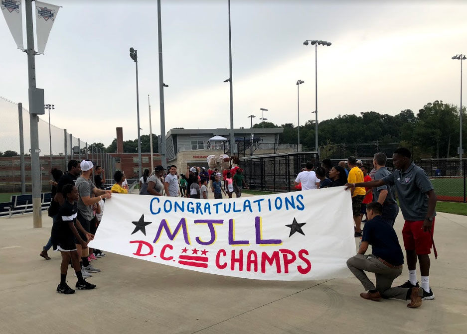 """""""It brings tears to my eyes. I think a lot of people feel this way, but these are our boys,"""" said Tal Alter, vice president of the Washington Nationals Youth Baseball Academy. (WTOP/Mike Murillo)"""