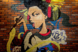 A geisha mural on one of the walls of the new JINYA Ramen Bar. (Courtesy Pike & Rose)