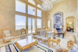Each room features elaborate detailing in gold and marble on the walls, molding and pillars. (Courtesy Phil and Victoria Gerdes)