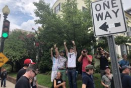 Counterprotesters are walking in front of the group of Unite The Right 2 protesters. There are lots of D.C. Police present. (WTOP/Max Smith)