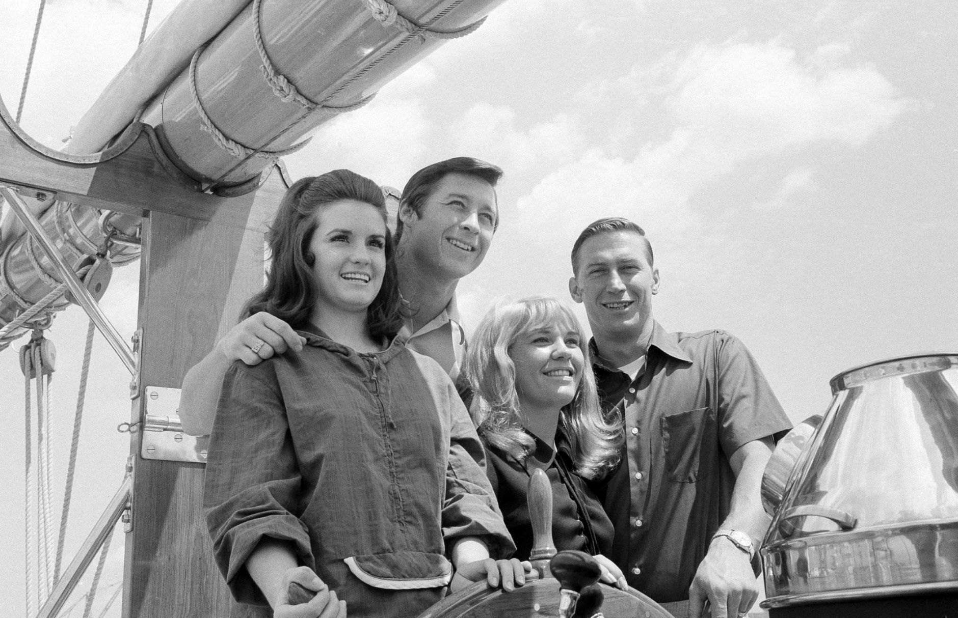 New York Yankees' Bobby Murcer and Mel Stottlemyre, right, pose with their wives Jean Stottlemyre and Kay Murcer  at the wheel of the schooner America during cruise on Long Island Sound, July 6, 1970. The vessel is a replica of the original America, which captured the first Americas Cup in 1851. (AP Photo/Harry Harris)