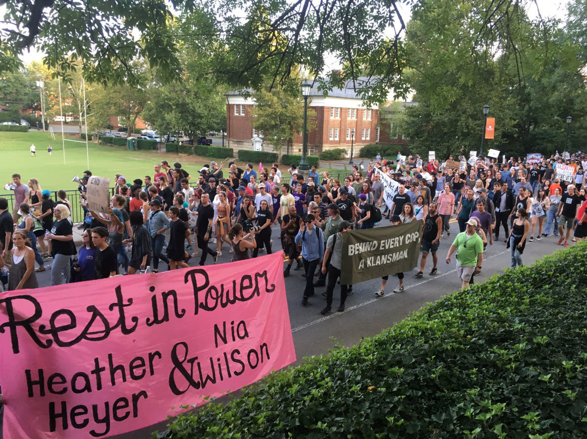 A student-led protest against the University of Virginia's response to last year's deadly protest and against white supremacy takes place Saturday, Aug. 11, 2018. (WTOP/Max Smith)